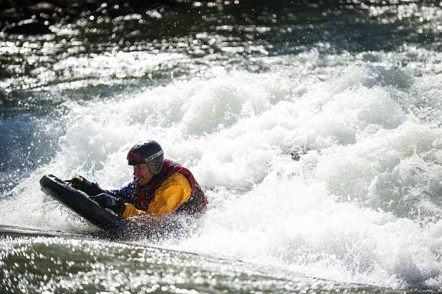 A man surfs the Basalt play wave on a boogie board during the whitewater park unveiling party this summer.