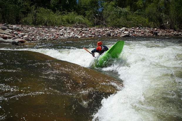 Tom Wills tests out the Pitkin County Whitewater Park in Basalt this summer.