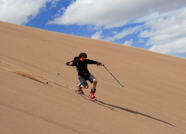 Hayden Kennedy tele-turns at the Great Sand Dunes in southern Colorado during a CRMS outing. (Kayo Ogilby / Courtesy photo)