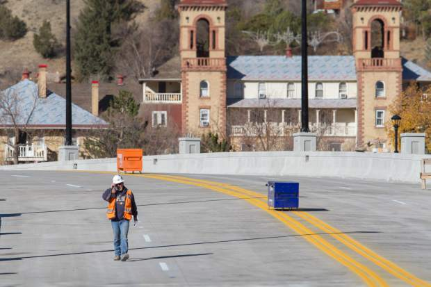 Crews painted lines on the new Grand Avenue bridge the Thursday before opening.