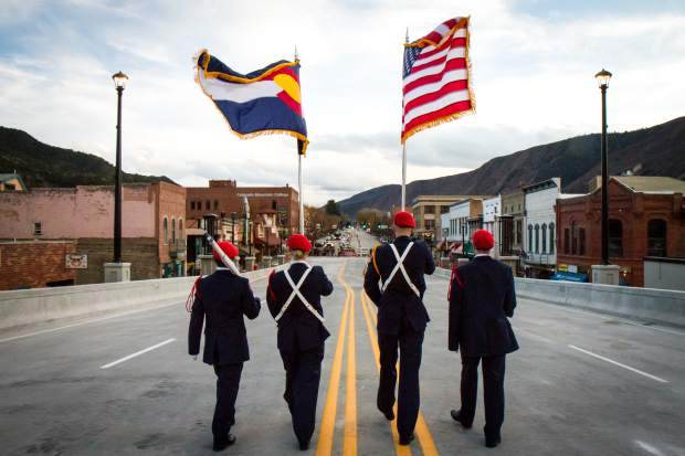The Glenwood Springs High School Air Force JROTC leads the crowd of roughly 3,000 across the new Grand Avenue bridge after the official ribbon cutting ceremony on Monday, Nov. 7.