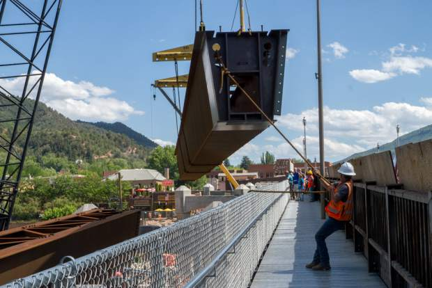 Construction crews place the steel beams, or girders, on the north side of the Colorado River. The placement of the beams periodically shut down the temporary pedestrian bridge as well as full closure of the Grand Avenue bridge from 8 p.m. to 6 a.m.