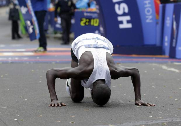 Geoffrey Kamworor of Kenya reacts after crossing the finish line first in the men's division of the New York City Marathon in New York, Sunday, Nov. 5, 2017. (AP Photo/Seth Wenig)