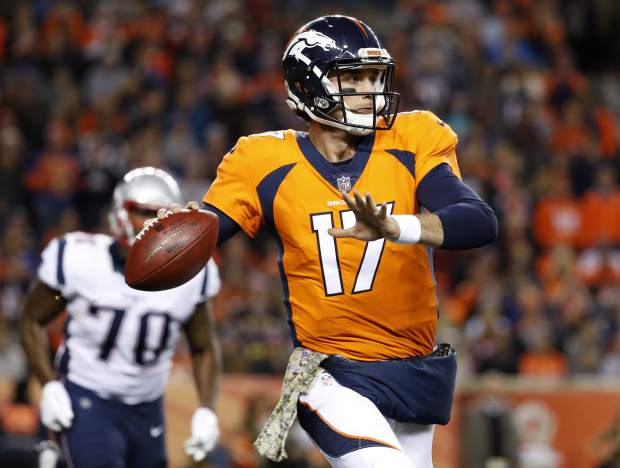 Denver Broncos quarterback Brock Osweiler (17) throws against the New England Patriots during the first half of an NFL football game, Sunday, Nov. 12, 2017, in Denver. (AP Photo/Jack Dempsey)