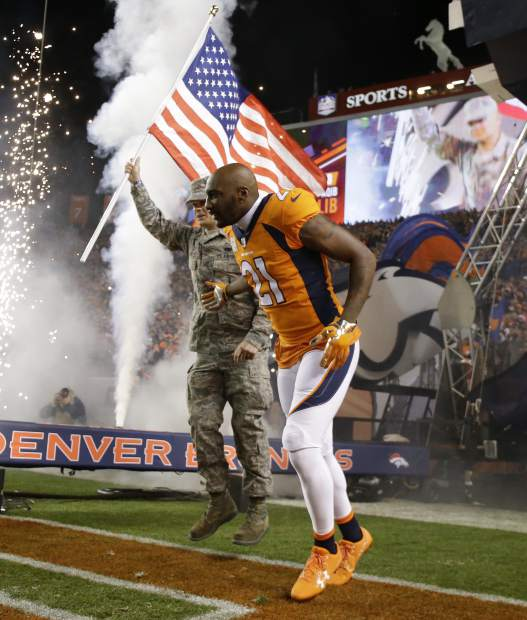 Denver Broncos cornerback Aqib Talib (21) takes the field with a U.S. Air Force airman as part of the NFL's Salute to Service prior to an NFL football game against the New England Patriots, Sunday, Nov. 12, 2017, in Denver. (AP Photo/Jack Dempsey)