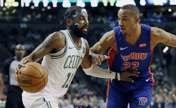 Boston Celtics' Kyrie Irving (11) drives past Detroit Pistons' Avery Bradley (22) during the first quarter of an NBA basketball game in Boston, Monday, Nov. 27, 2017. (AP Photo/Michael Dwyer)