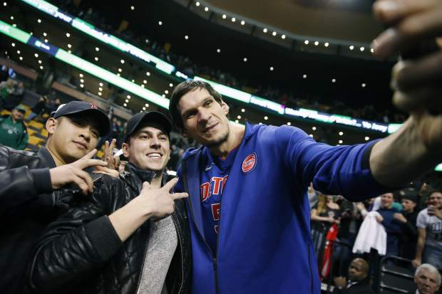 Detroit Pistons' Boban Marjanovic takes a selfie with fans following an NBA basketball game against the Boston Celtics in Boston, Monday, Nov. 27, 2017. The Pistons won 118-108. (AP Photo/Michael Dwyer)