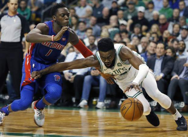 Detroit Pistons' Reggie Jackson (1) fouls Boston Celtics' Jaylen Brown during the second quarter of an NBA basketball game in Boston, Monday, Nov. 27, 2017. (AP Photo/Michael Dwyer)