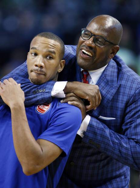 Former Boston Celtics' Cedric Maxwell, right, jokes with Detroit Pistons' Avery Bradley, also a former Celtics player, before an NBA basketball game in Boston, Monday, Nov. 27, 2017. (AP Photo/Michael Dwyer)