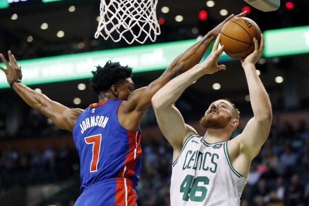 Boston Celtics' Jaylen Brown (7) blocks a shot by Boston Celtics' Aron Baynes (46) during the first quarter of an NBA basketball game in Boston, Monday, Nov. 27, 2017. (AP Photo/Michael Dwyer)