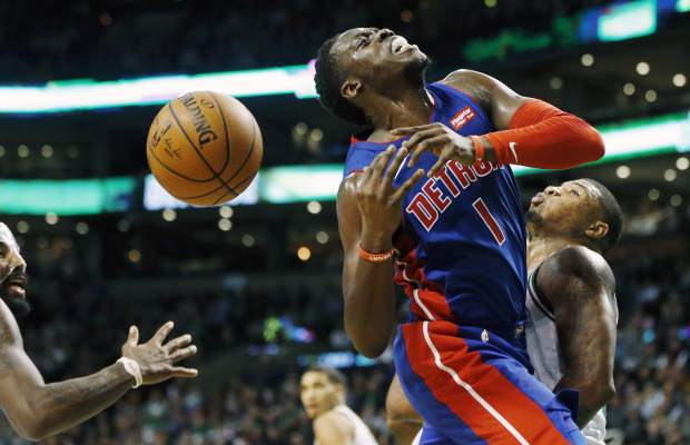 Detroit Pistons' Reggie Jackson (1) loses control of the ball as he drives for the basket against Boston Celtics' Marcus Smart, right, during the fourth quarter of an NBA basketball game in Boston, Monday, Nov. 27, 2017. The Pistons won 118-108. (AP Photo/Michael Dwyer)