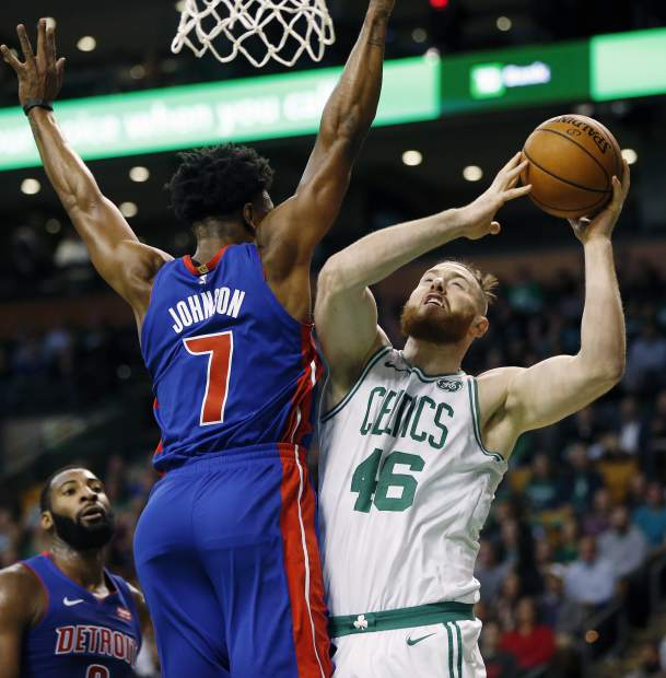 Boston Celtics' Aron Baynes (46) goes up to shoot against Detroit Pistons' Stanley Johnson (7) during the first quarter of an NBA basketball game in Boston, Monday, Nov. 27, 2017. (AP Photo/Michael Dwyer)