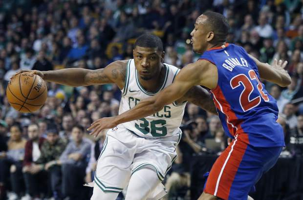 Boston Celtics' Marcus Smart (36) drives past Detroit Pistons' Avery Bradley (22) during the first quarter of an NBA basketball game in Boston, Monday, Nov. 27, 2017. (AP Photo/Michael Dwyer)