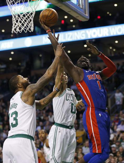 Detroit Pistons' Reggie Jackson (1) goes up to shoot against Boston Celtics' Marcus Morris (13) and Jayson Tatum (0) during the third quarter of an NBA basketball game in Boston, Monday, Nov. 27, 2017. The Pistons won 118-108. (AP Photo/Michael Dwyer)