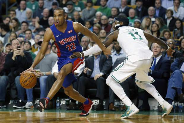 Detroit Pistons' Avery Bradley (22) drives past Boston Celtics' Kyrie Irving (11) during the third quarter of an NBA basketball game in Boston, Monday, Nov. 27, 2017. The Pistons won 118-108. (AP Photo/Michael Dwyer)