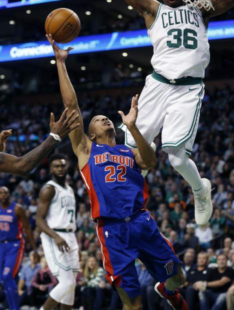Boston Celtics' Marcus Smart (36) fouls Detroit Pistons' Avery Bradley (22) during the third quarter of an NBA basketball game in Boston, Monday, Nov. 27, 2017. The Pistons won 118-108. (AP Photo/Michael Dwyer)