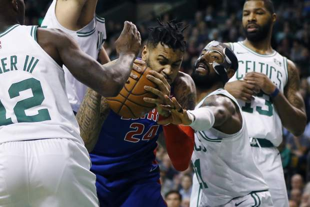 Detroit Pistons' Eric Moreland (24) struggles for control of the ball against Boston Celtics' Kyrie Irving (11) during the fourth quarter of an NBA basketball game in Boston, Monday, Nov. 27, 2017. The Pistons won 118-108. (AP Photo/Michael Dwyer)
