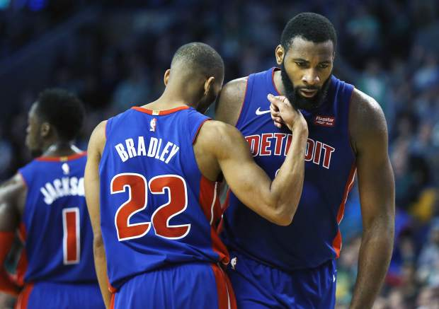 Detroit Pistons' Avery Bradley (22) reacts after teammate Andre Drummond, right, was fouled during the fourth quarter of an NBA basketball game against the Boston Celtics in Boston, Monday, Nov. 27, 2017. The Pistons won 118-108. (AP Photo/Michael Dwyer)