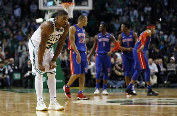 Boston Celtics' Marcus Smart (36) waits for a free throw from the Detroit Pistons during the fourth quarter of an NBA basketball game in Boston, Monday, Nov. 27, 2017. The Pistons won 118-108. (AP Photo/Michael Dwyer)
