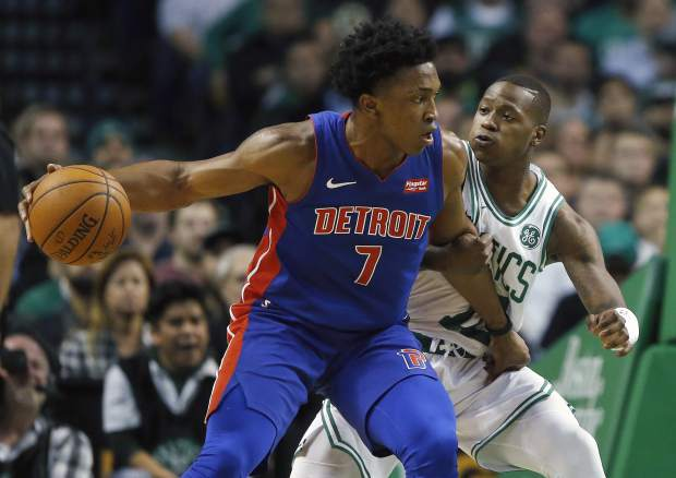 Detroit Pistons' Stanley Johnson (7) drives past Boston Celtics' Terry Rozier (12) during the first quarter of an NBA basketball game in Boston, Monday, Nov. 27, 2017. (AP Photo/Michael Dwyer)