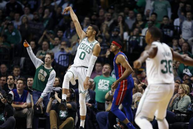 Boston Celtics' Jayson Tatum (0) watches his three-pointer during the third quarter of an NBA basketball game against the Detroit Pistons in Boston, Monday, Nov. 27, 2017. The Pistons won 118-108. (AP Photo/Michael Dwyer)