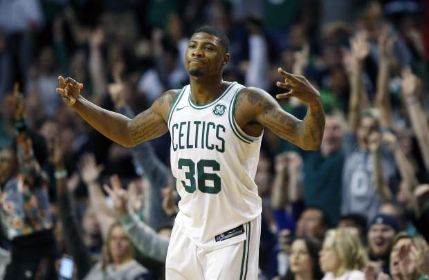 Boston Celtics' Marcus Smart celebrates after making a three-pointer during the fourth quarter of an NBA basketball game against the Detroit Pistons in Boston, Monday, Nov. 27, 2017. The Pistons won 118-108. (AP Photo/Michael Dwyer)