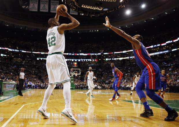 Boston Celtics' Al Horford (42) takes a shot against Detroit Pistons' Andre Drummond (0) during the first quarter of an NBA basketball game in Boston, Monday, Nov. 27, 2017. (AP Photo/Michael Dwyer)