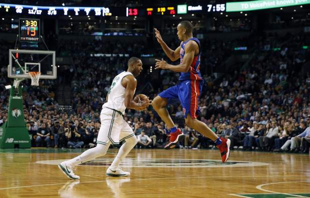 Detroit Pistons' Avery Bradley (22) defends against Boston Celtics' Al Horford (42) during the first quarter of an NBA basketball game in Boston, Monday, Nov. 27, 2017. (AP Photo/Michael Dwyer)