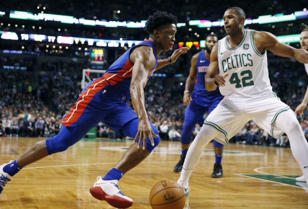 Detroit Pistons' Stanley Johnson (7) drives past Boston Celtics' Al Horford (42) during the third quarter of an NBA basketball game in Boston, Monday, Nov. 27, 2017. The Pistons won 118-108. (AP Photo/Michael Dwyer)
