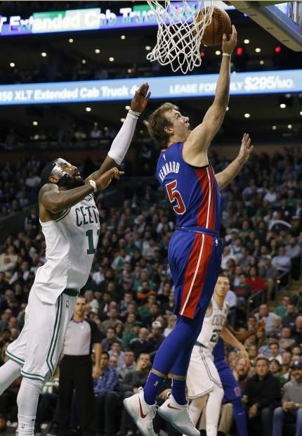 Detroit Pistons' Luke Kennard (5) shoots in front of Boston Celtics' Kyrie Irving (11) during the fourth quarter of an NBA basketball game in Boston, Monday, Nov. 27, 2017. The Pistons won 118-108. (AP Photo/Michael Dwyer)