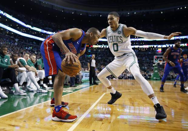 Boston Celtics' Jayson Tatum (0) defends against Detroit Pistons' Avery Bradley (22) during the fourth quarter of an NBA basketball game in Boston, Monday, Nov. 27, 2017. The Pistons won 118-108. (AP Photo/Michael Dwyer)