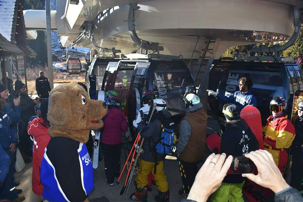 Copper resident Frank Walter, age 95, greets skiers and snowboarders at the base of American Eagle chairlift during opening day Friday, Nov. 10, at Copper Mountain.