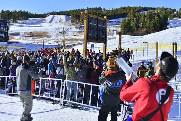 Skiers and snowboarders try to entice a resort employee armed with an air cannon to blast T-shirts their way Friday at Breckenridge Ski Resort.