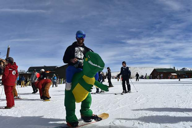 Skiers and snowboarders ride on the snow during opening day Friday, Nov. 10, at Copper Mountain.