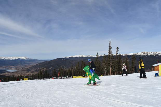 Skiers ride on the American Eagle chairlift during opening day Friday, Nov. 10, at Copper Mountain.