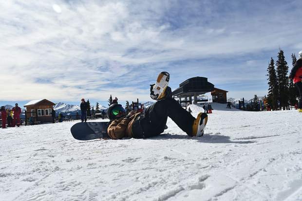 Skiers take photos on the mountain during opening day Friday, Nov. 10, at Keystone Resort.