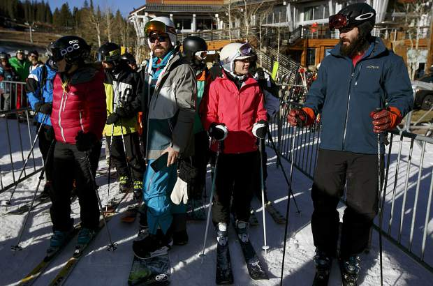 First chair riders await their seats on the American Eagle lift during the opening day at Friday, Nov. 10, at Copper Mountain.