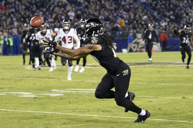 Baltimore Ravens wide receiver Chris Moore catches a pass from Ravens punter Sam Koch (4) for a first down on a fake punt play in the first half of an NFL football game against the Houston Texans, Monday, Nov. 27, 2017, in Baltimore. (AP Photo/Nick Wass)