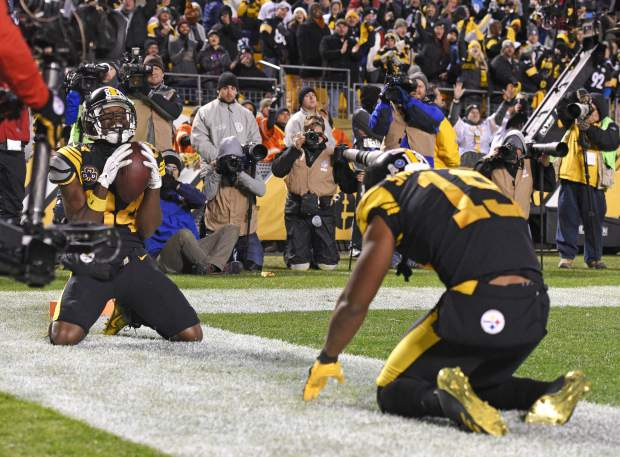 7a200b083 Pittsburgh Steelers wide receiver Antonio Brown (84) celebrates with wide  receiver JuJu Smith-Schuster (19) after his touchdown catch during the  second half ...