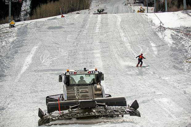 Snowcats push snow on Little Nell at Aspen Mountain Tuesday in preparation of opening day. About 100 acres of terrain will open Thursday on Aspen Mountain.