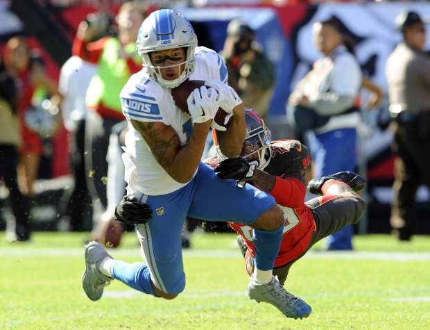 FILE - In this Dec. 10, 2017, file photo, Detroit Lions wide receiver Marvin Jones (11) makes a catch in front of Tampa Bay Buccaneers cornerback Ryan Smith (29) during the first half of an NFL football game in Tampa, Fla. Jones doesn't see a lot of nostalgia in this weekend's matchup at Cincinnati. Jones spent his first four years in the NFL with the Bengals before signing with the Lions in 2016, but he says facing his former team is of little significance to him. (AP Photo/Steve Nesius, File)