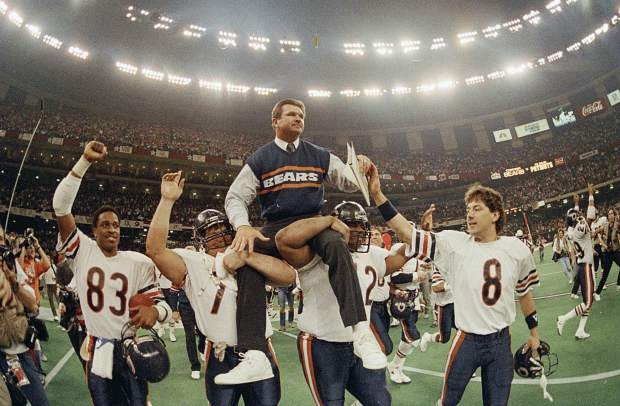 FILE- In this Jan. 26, 1986, file photo, Chicago Bears head coach Mike Ditka is carried off the field by Steve McMichael, left, and William Perry after the Bears defeated the New England Patriots 46-10 in Super Bowl XX in New Orleans. Argue all you want about which is the best team in NFL annals. The Pro Football Hall of Fame has opted for the 1985 Chicago Bears. The Canton shrine will premiere