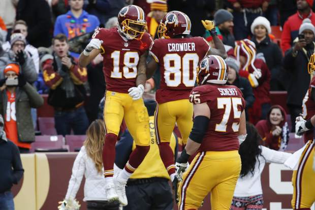 Washington Redskins wide receiver Josh Doctson (18) celebrates his touchdown with wide receiver Jamison Crowder (80) during the second half an NFL football game against the Denver Broncos in Landover, Md., Sunday, Dec 24, 2017. (AP Photo/Alex Brandon)