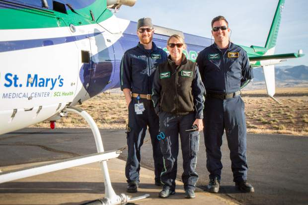 Care Flight crew members (from left to right) Flight Paramedic Ryan Griffin, Flight Nurse Kelly Thompson and Pilot Josh Thorne.