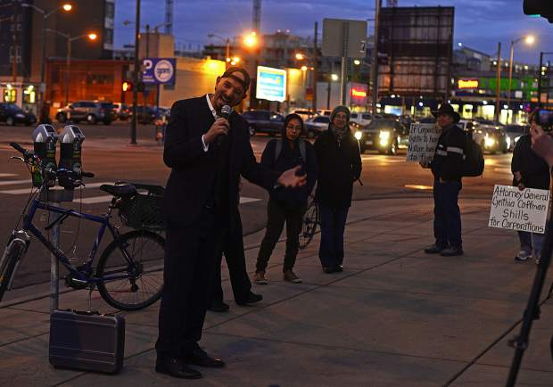 Jason Flores-Williams, the lawyer representing the Colorado River, speaks to protestors outside the Alfred A. Arraj Courthouse in downtown Denver.