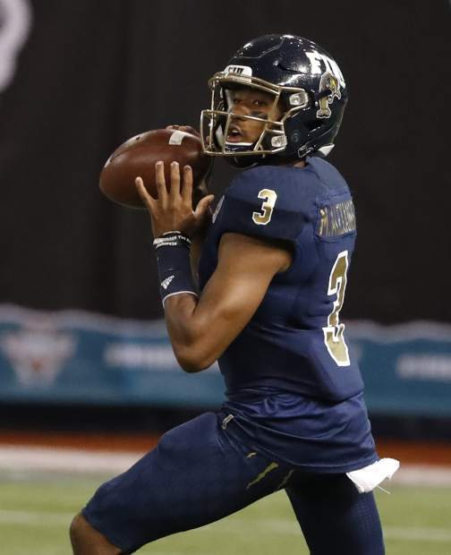FIU quarterback Maurice Alexander looks for a receiver during the first half of the Gasparilla Bowl NCAA college football game against Temple on Thursday, Dec. 21, 2017, in St. Petersburg, Fla. (Al Diaz/Miami Herald via AP)