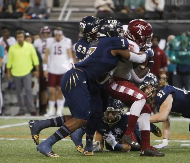 Temple running back David Hood (24) is tackled by Florida International defensive lineman Fermin Silva (7) during the first half of the Gasparilla Bowl NCAA college football game Thursday, Dec. 21, 2017, in St. Petersburg, Fla. (Octavio Jones/The Tampa Bay Times via AP)