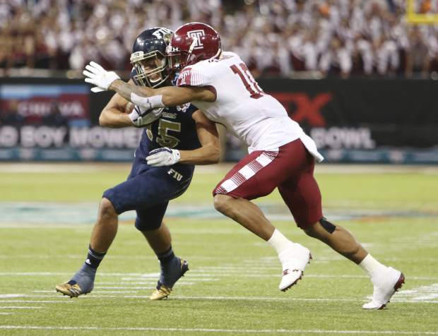 FIU wide receiver Austin Maloney (15) gets tackled by Temple defensive back Mike Jones (10) during the second half of the Gasparilla Bowl NCAA college football game Thursday, Dec. 21, 2017, in St. Petersburg, Fla. (Octavio Jones/The Tampa Bay Times via AP)