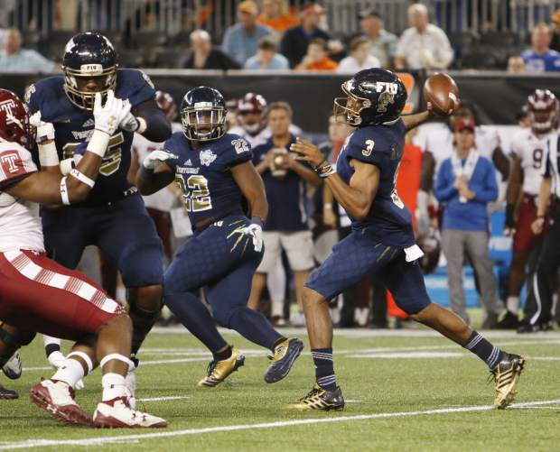FIU quarterback Maurice Alexander (3) prepares to throw the ball against the Temple during the first half of the Gasparilla Bowl NCAA college football game Thursday, Dec. 21, 2017, in St. Petersburg, Fla. (Octavio Jones/The Tampa Bay Times via AP)