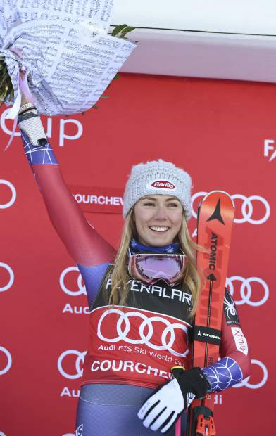 United States's Mikaela Shiffrin celebrates winning an alpine ski, women's World Cup giant slalom in Courchevel, France, Tuesday, Dec. 19, 2017. (AP Photo/Marco Tacca)